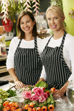 Portrait Of Two Sales Assistants In Florists Shop royalty free stock photos