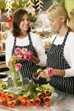 Portrait Of Two Sales Assistants In Florists Shop Stock Photos