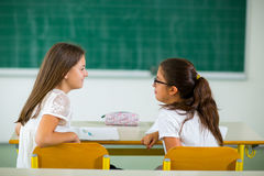 Portrait of two schoolgirls in a classroom. Stock Photo