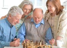 Men playing chess Royalty Free Stock Image