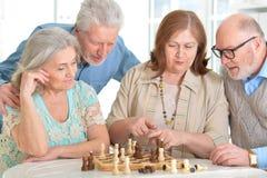 Men playing chess stock photo