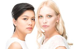 Strict women. Portrait of two serious women looking at camera Stock Image