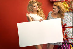 Portrait of two sexy girl with board Stock Image