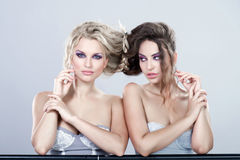 Portrait of a two sexy young women. Stock Image