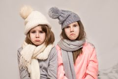 Portrait of two sick little sisters with sad face stock image