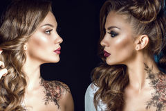 Portrait of two sides of the same woman. One half symbolizes her good nature, another one is a dark side. Human nature concept. Close up portrait of two sides of Royalty Free Stock Images