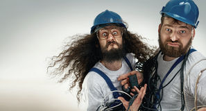 Portrait of two silly engineers Royalty Free Stock Images