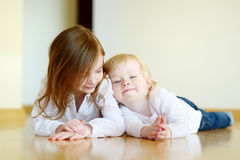 Portrait of two sisters at home Royalty Free Stock Photography