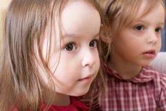 Portrait of two sisters looking at mother Royalty Free Stock Photo