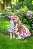 Portrait of two sisters in a park Royalty Free Stock Photos