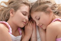 Two sisters twins Stock Image