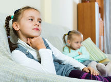 Portrait of two small upset miserable girls having conflict Stock Image