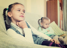 Portrait of two small upset miserable girls having conflict. At home Stock Photo