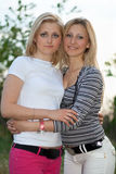 Portrait of two smiling beautiful young women stock photography