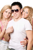 Portrait of a two smiling blonde women with young man Royalty Free Stock Photos