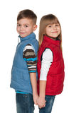 Two smiling children on the white background Royalty Free Stock Photos