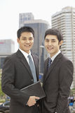 Portrait of two smiling and confident businessmen, looking at camera Royalty Free Stock Photo