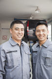 Portrait of Two Smiling Garage Mechanics Royalty Free Stock Photo