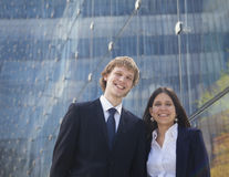 Portrait of two smiling young business people outdoors in Beijing, China Royalty Free Stock Images