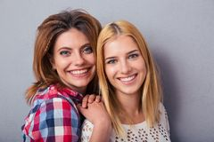 Portrait of a two smilng girl Stock Image