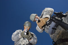 Portrait of two soldiers aiming with pistols Royalty Free Stock Images