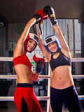 Portrait of two sport girl boxing on ring. Royalty Free Stock Image