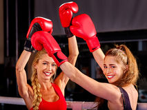 Portrait of two sport girl boxing on ring Stock Photos