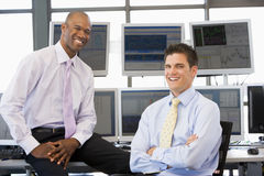 Portrait Of Two Stock Traders. At work Stock Photos