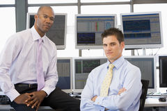 Portrait Of Two Stock Traders. At work Stock Images