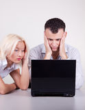 Portrait of two stressed people in office. Portrait of two people working with stress in office Royalty Free Stock Image