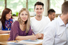 Portrait of two students in classroom Royalty Free Stock Images
