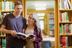 Portrait of two students reading book in the library Royalty Free Stock Image