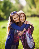 Portrait of two stylish  sisters outdoors Stock Images