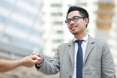 Portrait of two successful business executive exchanging business card Royalty Free Stock Image