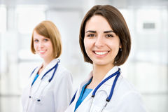 Portrait of two successful female doctors Stock Images