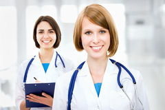 Portrait of two successful female doctors Royalty Free Stock Photo