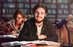 Portrait of Couple of Students in Library Royalty Free Stock Image