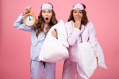 Portrait of two surprised pretty girls dressed in pajamas Royalty Free Stock Photo