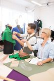 Experienced Tailors in Atelier stock images