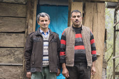 Portrait of Two Taleshi Herder in Front of a Chalet Stock Image