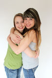 Portrait of Two teen girls hugging. Beautiful portrait of two smiling teen girls Royalty Free Stock Photography