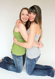 Portrait of Two teen girls hugging Stock Photos