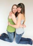 Portrait of Two teen girls hugging. Beautiful portrait of two smiling teen girls Stock Photos