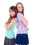 Portrait of two teen girls standing back-to-back Stock Photos