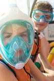 Portrait of two teenagers with masks and snorkels stock photo