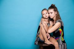 Portrait of two trendy girls in colorful clothes royalty free stock photos