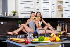 Portrait of Two twin sisters having fun in the morning preparing breakfast Royalty Free Stock Image