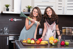 Portrait of Two twin sisters having fun in the morning preparing breakfast Royalty Free Stock Photography