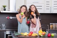 Portrait of Two twin sisters having fun in the morning preparing breakfast Stock Photo