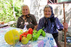 Portrait of two very old village women proud of their vegetables Stock Images